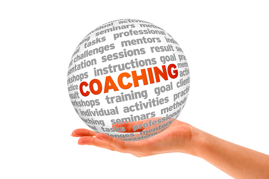 Hand holding a Coaching 3d Sphere on white background.